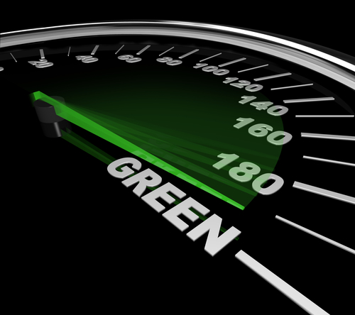 The needle on a speedometer points to the word Green