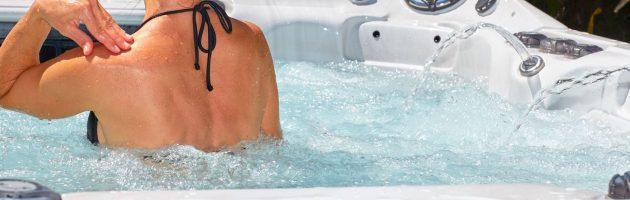61819382 - young beautiful woman relaxing in a hot tub